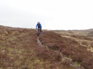 Jim Sutherland of nine-one-six guiding on the trail above Glen Carron